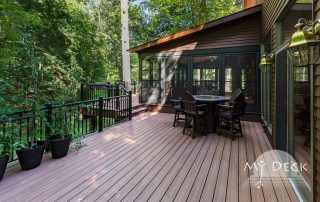 brown home with wood deck