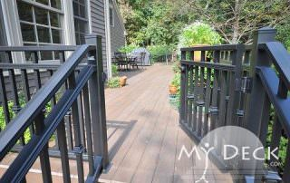 grey house with wood deck