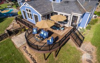 blue house with wood deck