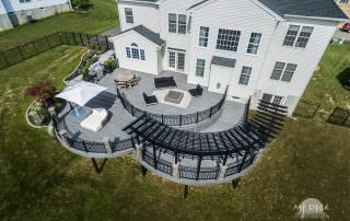 white house with wooden deck