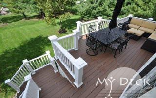 white house with wood deck