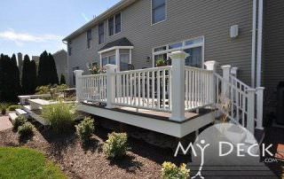 brown house with wood deck