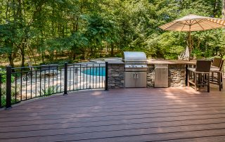 BBQ Area on deck with inground swimming pool